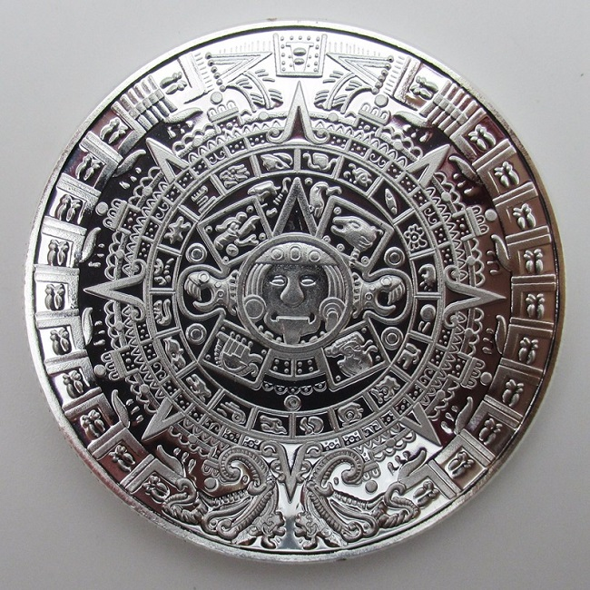 Монета с ацтекским календарем